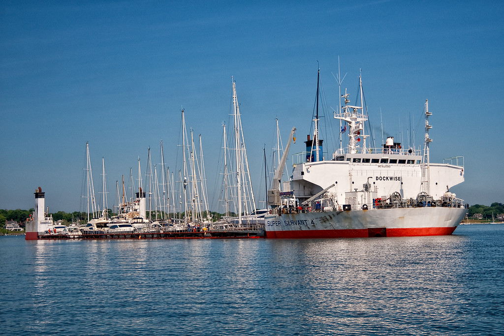 Super Servant 4 delivering yachts to Newport, Rhode Island, anchored in the east Passage of Narragansett Bay.