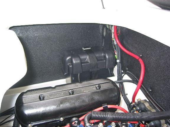 After Market Left Side Aftermarket Battery for redundancy / safety. And to run radio / inflatables pump when engine off.