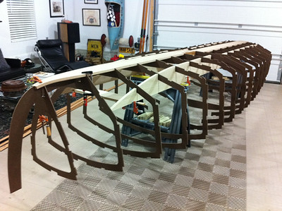 """Full-length stringers are now cut from 7/8"""" white oak and notched to receive each frame. The hull is now reassembled upside-down to check the integrity of the bottom portion of the hull. Again, all is well."""