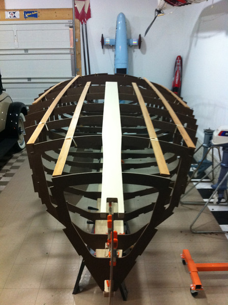 Once the king planks and batten strips were set in place, it was time to check the hull to ensure that it was fair.  A small inacuracy in the CNC drawings would cause a major problem later in the build.  The deck and sides of the hull appear to be perfect.