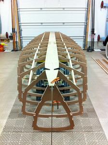 The notched stringers allow the skeleton to be assembled like a jig saw puzzle.  Each frame simply drops into its respective slot.