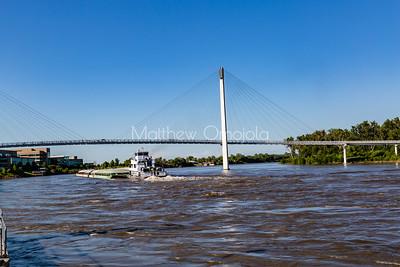 Barge moving North under Bob Kerrey Foot Bridge