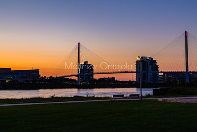 Riverfront Place  and Bob Kerrey Bridge after sunset