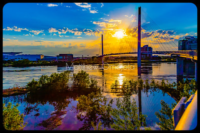 Bob Kerrey Pedestrian Bridge at Sunset with cables reflections in Missouri River