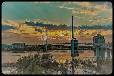 Bob Kerrey Foot Bridge at sunset over flooded Missouri River