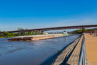 Barge moving up North under Douglas Street Bridge on Missouri River