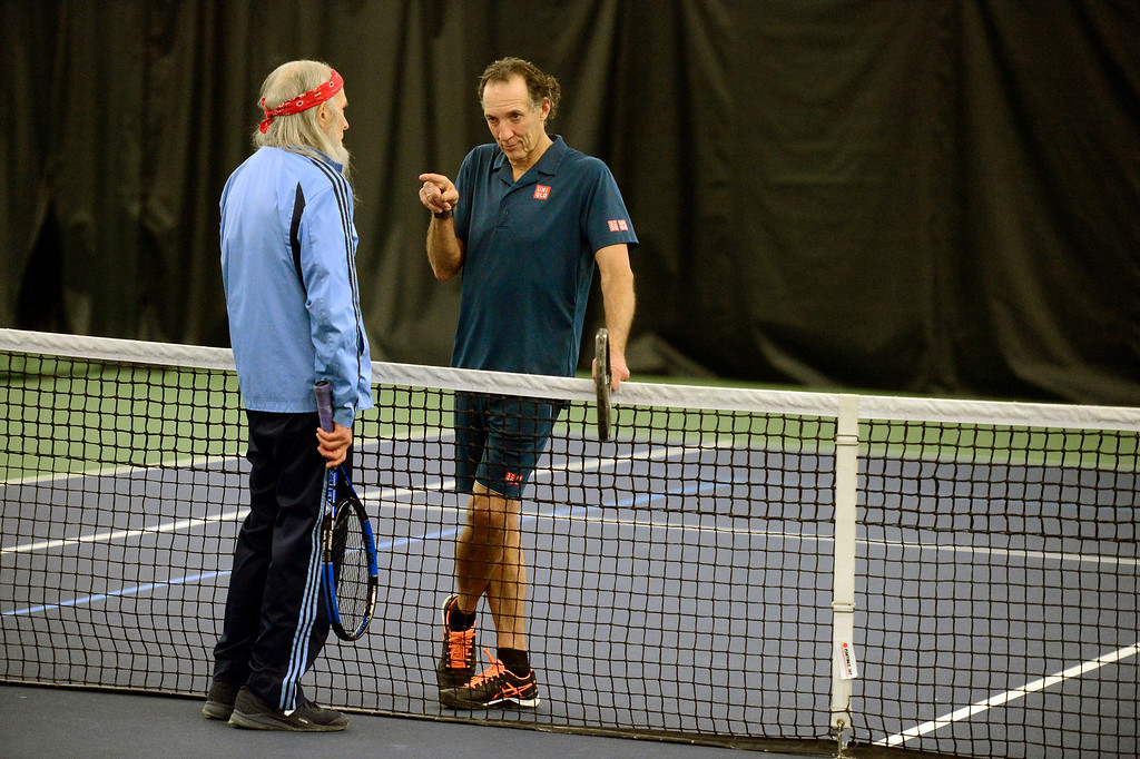 . BOULDER, CO FEBRUARY 7 2019 Bob Litwin, right, talks about some tennis strategy with partner Jay Burch at the Meadows Swim & Tennis Club on Thursday February 7, 2019.  (Photo by Paul Aiken/Staff Photographer)