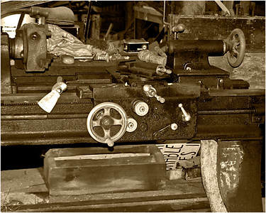An old lathe in the machine shop building.