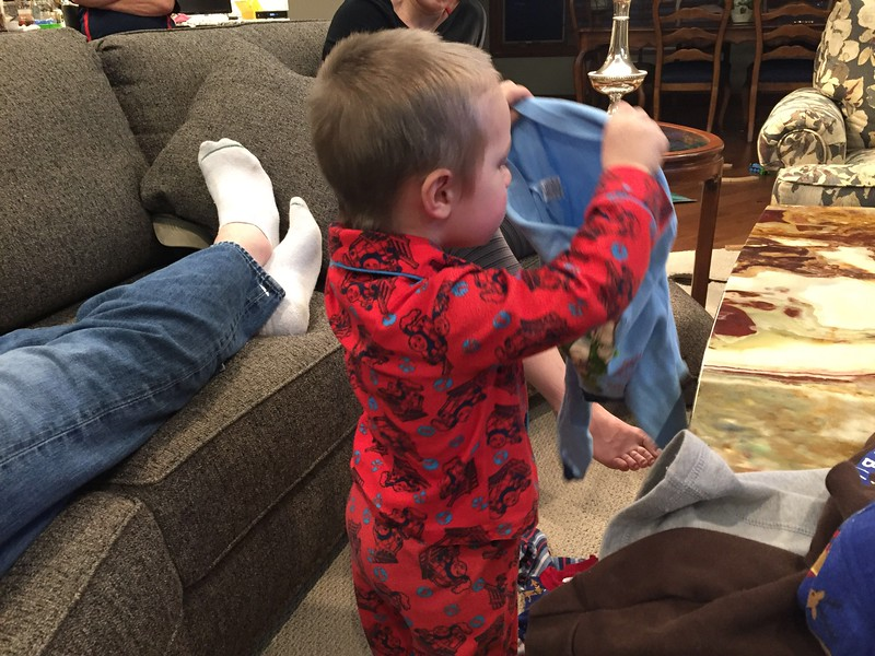 Trying on all of the clothes from cousin Alex! TJ was loving it! April 2016