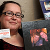 "Robin Gravlin, holds a ""pay it forward"" card and the back of a book about her son, Bobby Aguiar-Doyle, who was killed in 2015, she started the ""Bobby's Legacy Foundation"". SUN/David H. Brow"