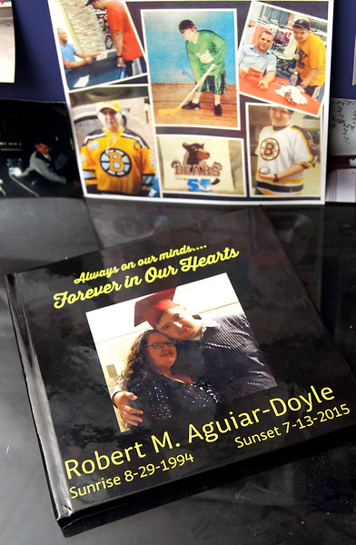 "Cover of a book and family photos of Bobby Aguiar-Doyle, who was killed in 2015, his mother, Robin Gravlin, started up ""Bobby's Legacy Foundation"". SUN/David H. Brow"