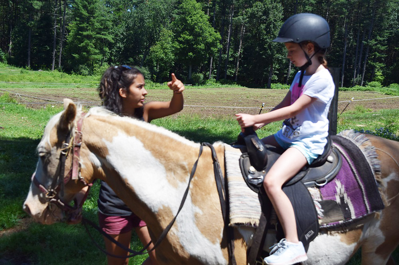 . Lianna Zerrmani, 8, of Lynnfield gets some last-minute instructions from Emma Ortega, an employee at Bobby s Ranch in Westford. SUN / SCOTT SHURTLEFF