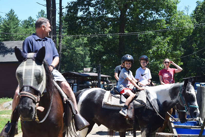 . Ken Mierz, of Westford, makes sure his sons, Cameron, 7, and Connor, 12, as well as Lindsay Holden of Concord, are ready to ride. SUN / SCOTT SHURTLEFF
