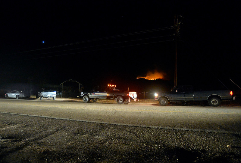 People ist in their cars on County Road 27 near the Masonviller Mercatile to watch the Bobcat Powerline wildfire as it burns an area north of Bobcat Ridge Natural Area west of Loveland on Thursday, Dec. 15, 2016. Early estimates put the fire at 20-25 acres. (Photo by Jenny Sparks/Loveland Reporter-Herald)