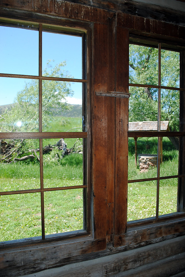 An old well, seen through the window of a historic cabin, provided water for families who lived and farmed on land near Masonville that is now the Bobcat Ridge Natural Area. ( Pamela Johnson / Loveland Reporter-Herald)