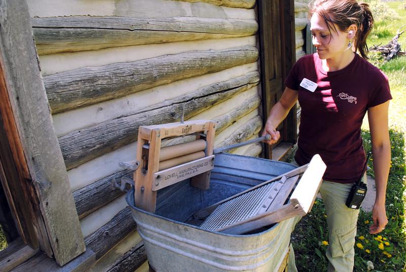 Emily Olivo, an educator with Fort Collins Natural Areas, demonstrates a hand wringer and wash board Saturday, June 4, 2016, that pioneers used during the time they lived in the historic cabin located at Bobcat Ridge Natural Area. (Pamela Johnson / Loveland Reporter-Herald)