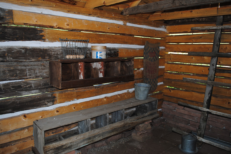 The inside of a restored chicken house with the original wooden boxes in which the chickens laid eggs and a wooden roost. This was restored as part of a project to save the history at Bobcat Ridge Natural Area. (Pamela Johnson/Loveland Reporter-Herald)