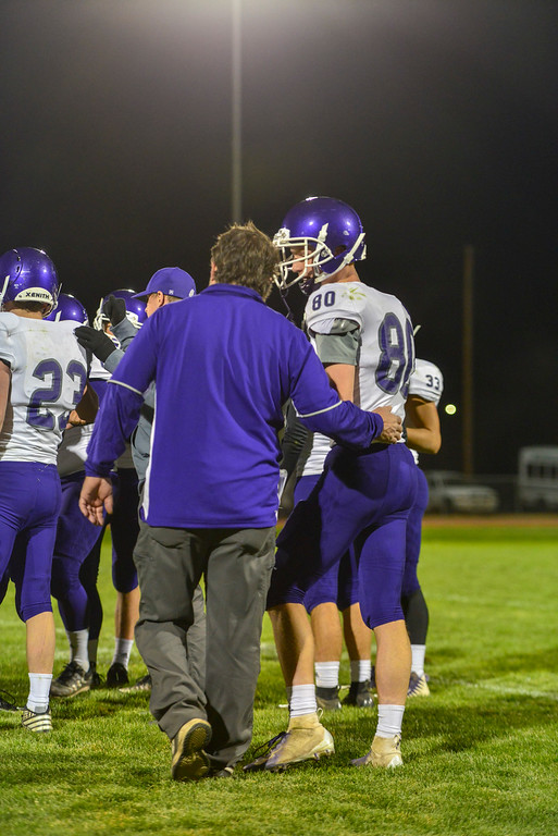 . Calum Torrey, right, recieves some support from Head Coach Tom Creech. The Bobcats lost their final game of the season against the Highland Huskies 47-3 in Ault, Colo., on Oct. 25.