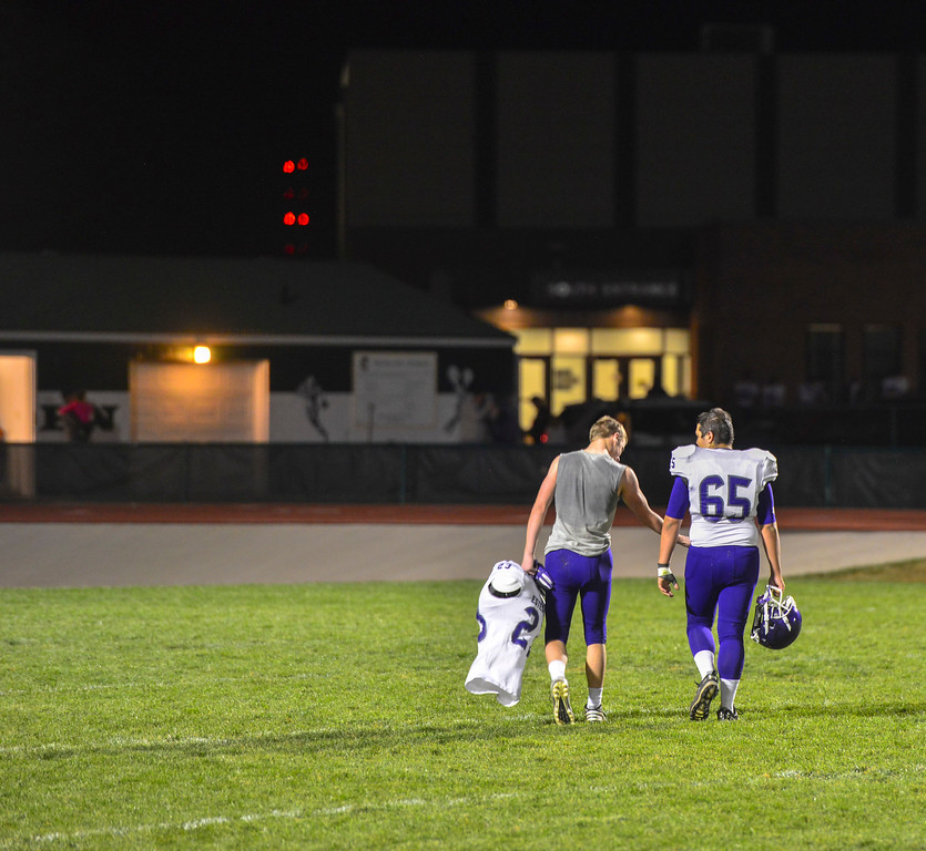 . Obadiah Jones, left, offers his teammate Raymond Mitchell some support after losing their last game of the season. The Bobcats lost 47-3 to the Highland Huskies in Ault, Colo., on Oct. 25.