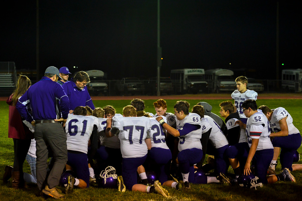 . The Bobcats gather together after their last game of the season to support each other and offer each other words of encouragement. The Bobcats lost 47-3 to the Highland Huskies in Ault, Colo., on Oct. 25.