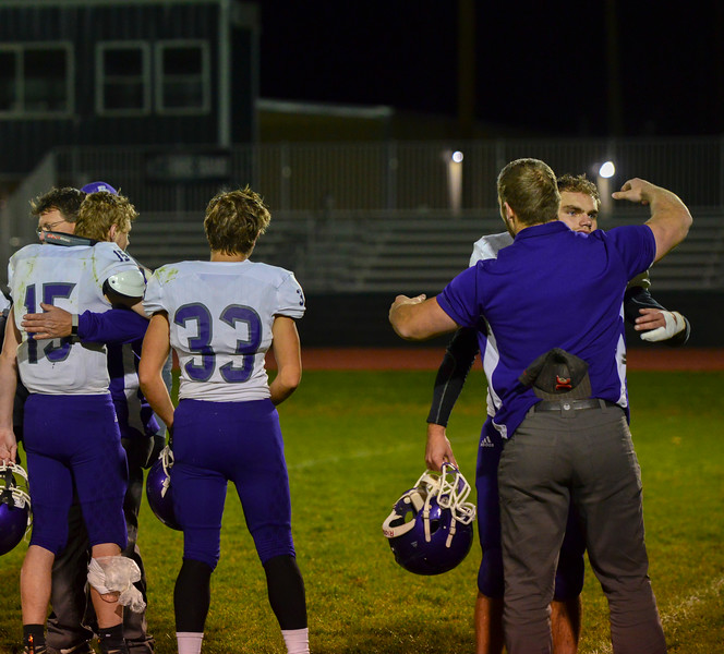 Cole Wallace, left and Bert Chrastil, right, get hugs from their coaches after their last game of the season. The Bobcats lost 47-3 to the Highland Huskies in Ault, Colo., on Oct. 25.