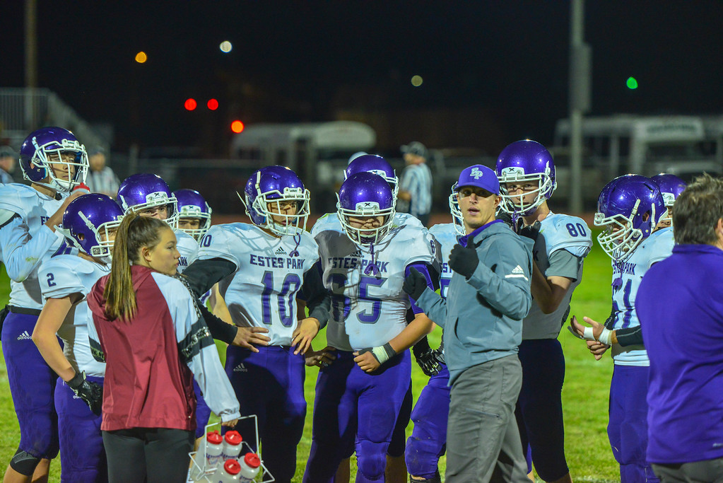 . The Estes Park varsity football team regroups during their last game of the season in Ault, Colo., on Oct 25. The Bobcats lost 47-3 to the Highland Huskies.