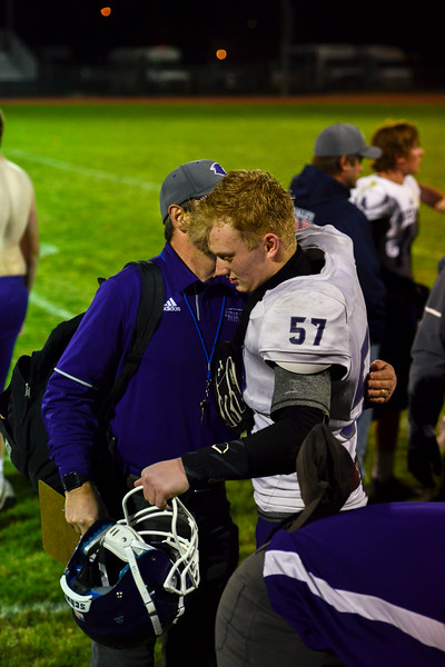Christian Acosta gets a hug from his coach after his last game of the season. The Bobcats lost 47-3 to the Highland Huskies in Ault, Colo., on Oct. 25.