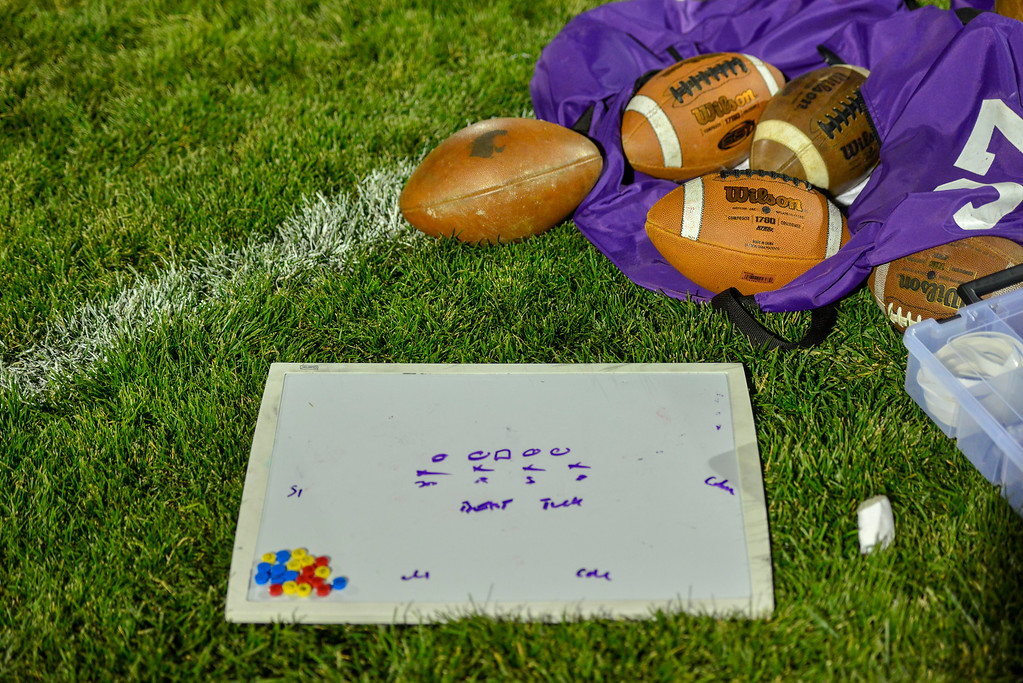 . Footballs and a white board with plays written on it sit behind the Estes Park football team�s bench. The Bobcats lost to the Highland Huskies 47-3 in Ault, Colo., on Oct. 25.