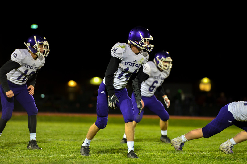 Tucker Johnson, left, JD McCown, middle and Bert Chrastil prepare to defend a snap from the Highland Huskies in their last game of the season in Ault, Colo., on Oct. 25. The Bobcats lost 47-3.