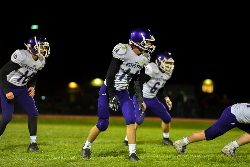 . Tucker Johnson, left, JD McCown, middle and Bert Chrastil prepare to defend a snap from the Highland Huskies in their last game of the season in Ault, Colo., on Oct. 25. The Bobcats lost 47-3.