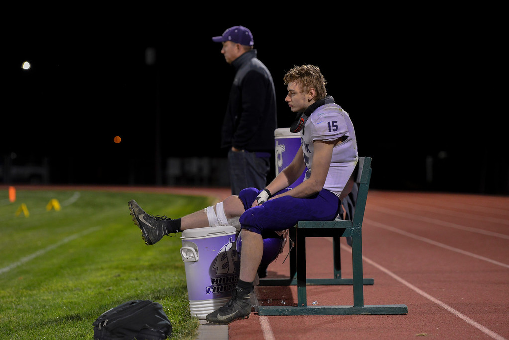 . Cole Wallace sits on the bench in pain. The Bobcats lost to the Highland Huskies 47-3 in Ault, Colo., on Oct. 25.