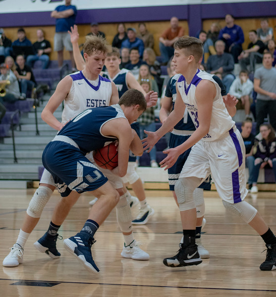 Ethan Hill, left and Kian Gerig double team a University High School player during the fourth quarter of a 64-47 loss at home on Jan. 29.
