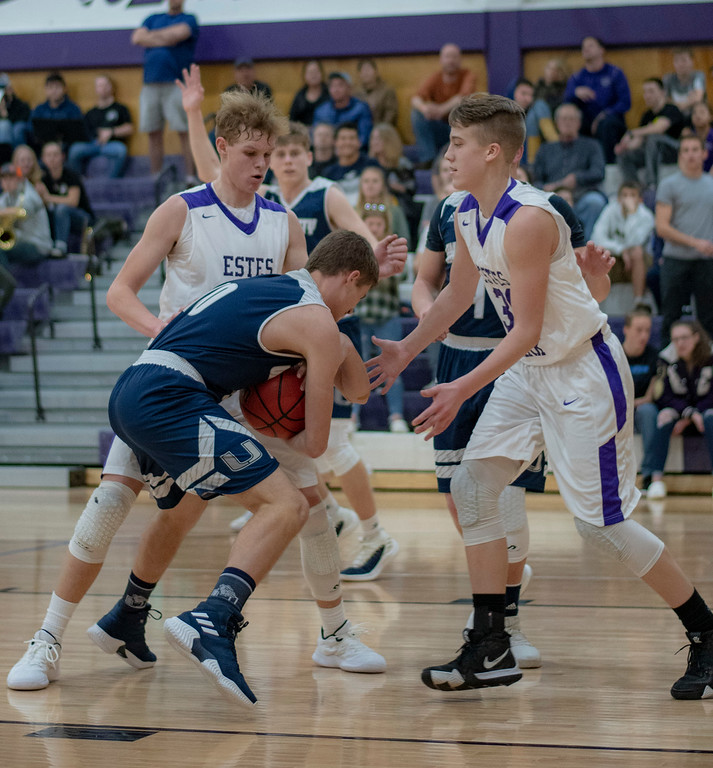 . Ethan Hill, left and Kian Gerig double team a University High School player during the fourth quarter of a 64-47 loss at home on Jan. 29.