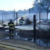 Firefighters from local departments work to put out a barn fire that killed 7,000 turkeys at Bob's Turkey Farm in Lancaster Thursday. SENTINEL & ENTERPRISE / Joe Atmonavage