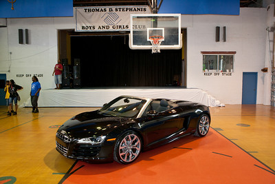 The first 2011 Audi R8 V10 Spyder Cabriolet convertible in the United States, is presented to the Fourth Annual 2010 BOCA RATON concours d'elegance live auction winner, Tom Gonzales