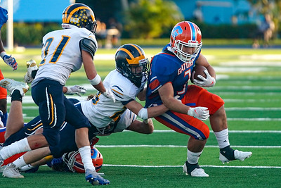 RB Adrian Santiago is tackled