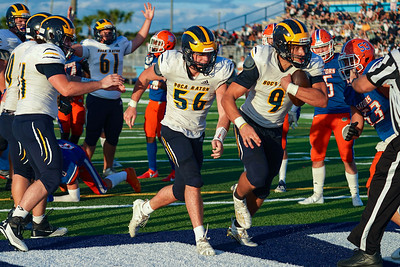 Boca's Ashton Gillotte scores a touchdown against Palm Beach Gardens in today's championship game
