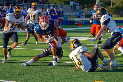 RB Adrian Santiago tries to avoid a tackle