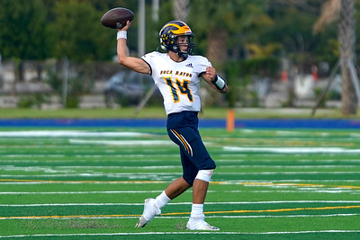 Boca High QB Jacob Cashion attempts a pass in today's championship game against Palm Beach Gardens
