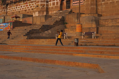 The ghats of Varanasi are not olny used for religious ceremonies, they serve as a place for social connections and recreation, in this case a game of cricket.