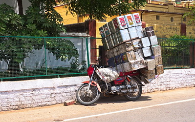 Loading a bike Indian style.