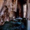 The homes were small.  As the wallpaper aged, it peels off the ceiling and looks like heavy drapes.