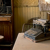 Old typewriter and early telephone switchboard are found in the hotel office.