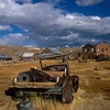Soon automobiles were used to get to Bodie.  There are a number of them of various vintages in fields near some of the old buildings.