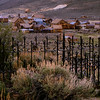 As the miners left, Bodie became a ghost town.  The cemetery is located on a hill that overlooks the town.  Many of the graves have markers.  It was common practice to surround the grave with wood and, then later,  metal fences.
