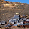The Standard Stamp Mill ran 24 hours a day crushing rock and extracting gold and silver.   It is estimated that over $34 million in bullion was produced here.   Bodie Bluff behind the mill shows the slag heaps near the mine shafts.