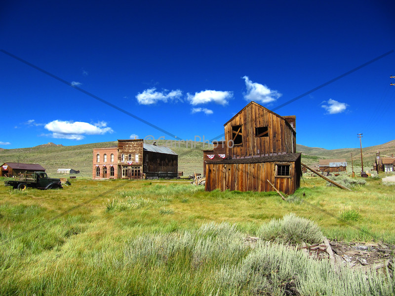 The town of Bodie, still decked out in flags from the 4th of July holiday.  The town is not restored but is kept in a state of arrested decay.