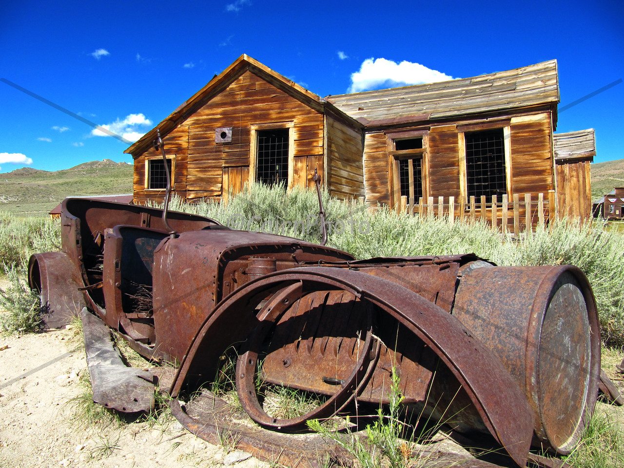 An abandoned car in front of a house in Bodie.  I can only imagine living here and driving up to my house in this car.