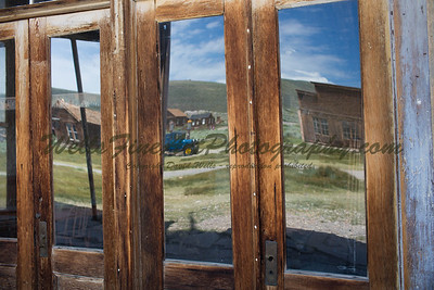 387A0537 Bodie blue truck reflected in windows