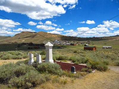 The town of Bodie from the town grave yard.  Ladies of the night (who were prevalent in Bodie) were not allowed to be buried within the grave yard proper so they were buried outside of the fence.  Bodie was a very violent gold town in the late 1800's.  It was declared a California State Park in 1962.